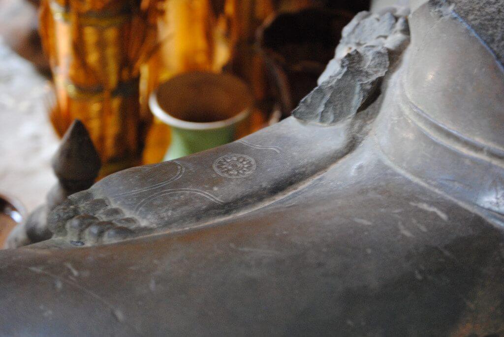 Der Kreis des Lebens unter dem Fuß von Buddha im Banteay Kdei Tempel