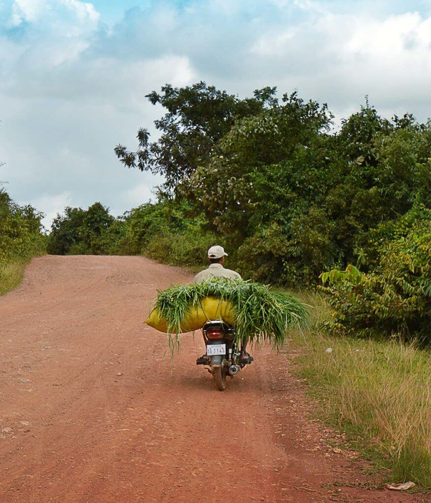 Motorradfahrer in Kampot, Kambodscha