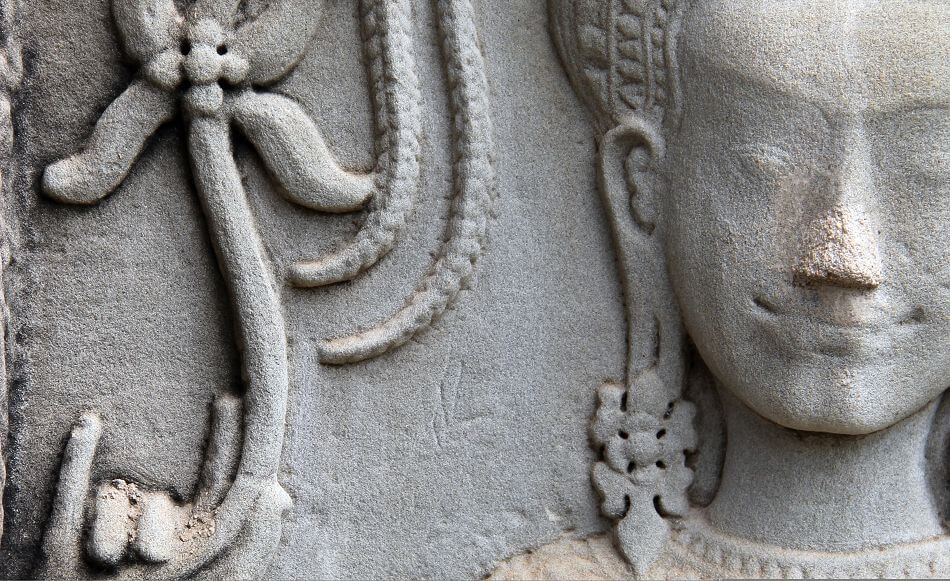 Apsara at Angkor Wat with Lotos