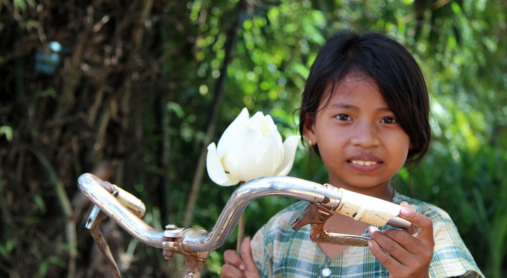 Girl with Lotus in Cambodia