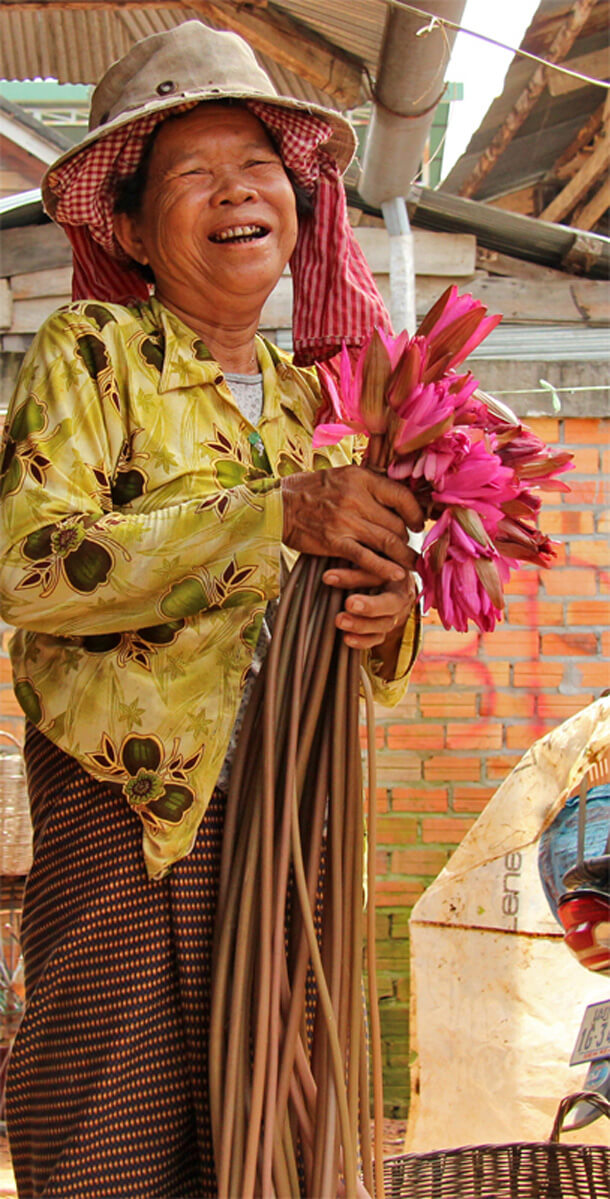 Woman with Lotus in Cambodia