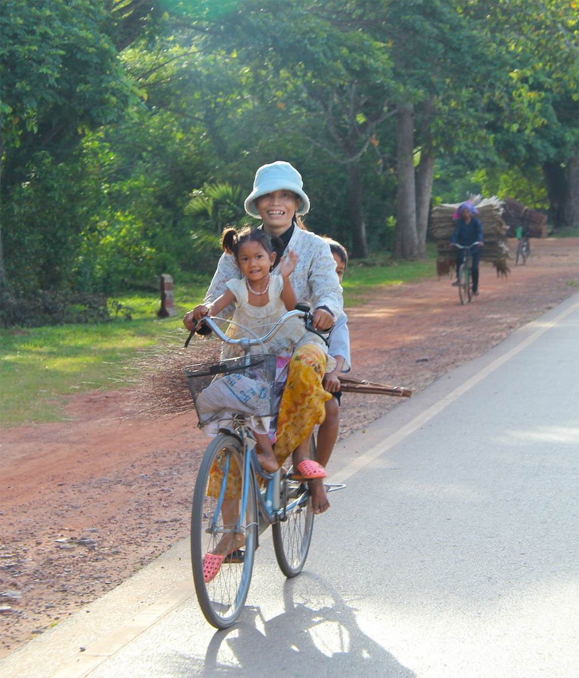 smiling family on a bycicle in Siem Reap