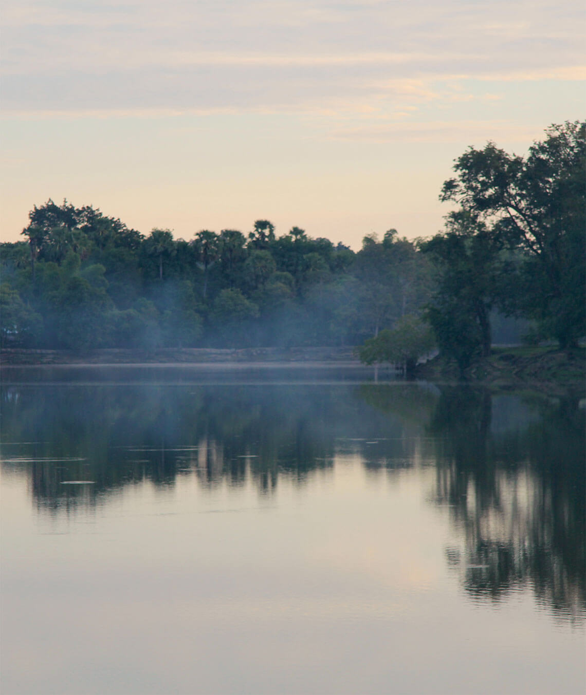 moat with fog in the morning at Angkor Wat