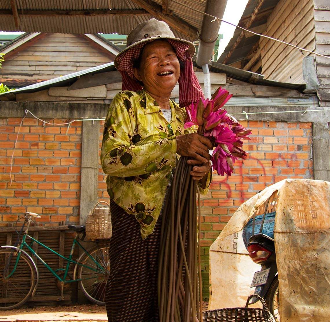 Vendor with lotus flowers at a market in Siem Reap