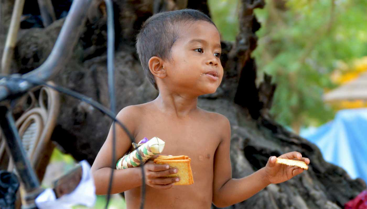 Boy with crackers - Ta Prohm Temple, Cambodai